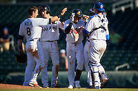 Mesa Solar Sox Yu-Cheng Chang (13), of the Cleveland Indians organization, is congratulated by teammates Austin Nola (8), Brian Anderson (14), Anthony Alford (22) and Danny Jansen (5) after a walk off hit during a game against the Scottsdale Scorpions on October 21, 2016 at Sloan Park in Mesa, Arizona.  Mesa defeated Scottsdale 4-3.  (Mike Janes/Four Seam Images)