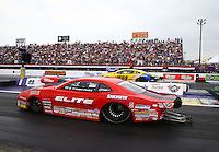 Apr 27, 2014; Baytown, TX, USA; NHRA pro stock driver Erica Enders-Stevens (near lane) races alongside Jeg Coughlin Jr during the Spring Nationals at Royal Purple Raceway. Mandatory Credit: Mark J. Rebilas-
