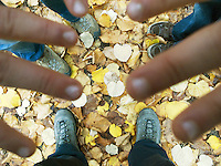 France. Paris. Didier, Nicola and Micaela Ruef at the Luxembourg garden. Fingers, shoes and yellow leaves on the ground. 03.11.09  © 2009 Didier Ruef