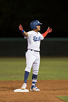 AZL Dodgers center fielder Ismael Alcantara (5) celebrates after hitting a double during an Arizona League game against the AZL White Sox at Camelback Ranch on July 3, 2018 in Glendale, Arizona. The AZL Dodgers defeated the AZL White Sox by a score of 10-5. (Zachary Lucy/Four Seam Images)