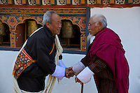 Talo Tshechu Festival with Dramitse Nga Cham (sacred Mask dance of Drum and Stick) Bhutan, & the old Gentleman on the right is the famous Bhutanese singer Ap Dhopay who is from Talo under Punakha district. He has been serving the 3rd King for many years and later joined the Royal Academy of Performing Arts (famously known as Royal Dancer) He sang many traditional songs and is keen in the preservation of the culture and tradition in Bhutan. He was awarded a Silver Jubilee Gold Medal in the year 1999 by the 4th King of Bhutan.