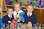 BREAK: Geroid Walsh, Molly Frehill and Pauric Meaney junior infants playing with their toys as they take a break from school at Abbeydorney NS on Monday. ... ....