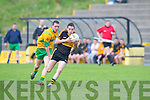 Brian Looney Crokes goes past Padraig O'Connor Gneeveguilla in their Castleisland Mart club Championship game in Killarney on Saturday night