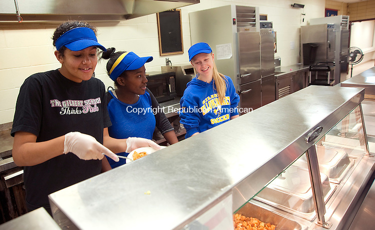 WINSTED, CT-011014JS04- Members of the Gilbert School basketball team , from left, Deanna Delacruz , Alexis Johnson-Blue and Grace Balickis, serve breakfast to guests during a fundraiser breakfast at the school on Sunday. The team is looking to raise money to fund a trip to China in April 2015. During the trip they plan to visit the school's two sister schools as well as hold basketball clinics and hold exhibition games. Also during the visit they will give talks about the American educational system. <br /> Jim Shannon Republican-American