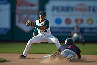 Fort Wayne TinCaps shortstop Tucupita Marcano (15) prepares to apply a tag to Ford Proctor (9) of the Bowling Green Hot Rods as he attempts to steal second base at Parkview Field on August 20, 2019 in Fort Wayne, Indiana. The Hot Rods defeated the TinCaps 6-5. (Brian Westerholt/Four Seam Images)