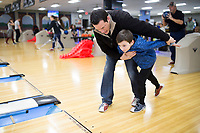 NWA Democrat-Gazette/CHARLIE KAIJO Chuck Houghland of Farmington (right) teaches his boy Drew Houghland, 6, how to bowl Sunday, February 11, 2018 at the Rogers Bowling Center in Rogers. Low temperatures left many of the roads icey. <br />