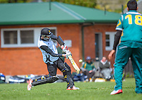 Steve Murdoch hits a six during the Ewen Chatfield Trophy Wellington premier men's club cricket match between Karori and Naenae at Benburn Park, Karori, Wellington, New Zealand on Sunday, 31 October 2015. Photo: Dave Lintott / lintottphoto.co.nz