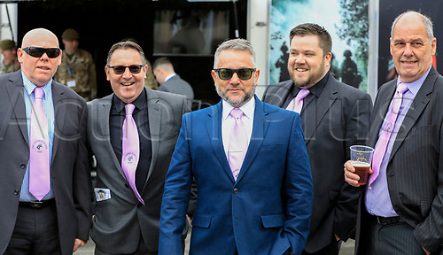 14h April 2018, Aintree Racecourse, Liverpool, England; The 2018 Grand National horse racing festival sponsored by Randox Health, day 3; Men with their Grand National purple ties