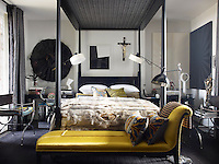 The master bedroom is dominated by a Zandberg-designed four-poster bed and includes a spectacular Zulu skirt amongst the objects displayed around the walls