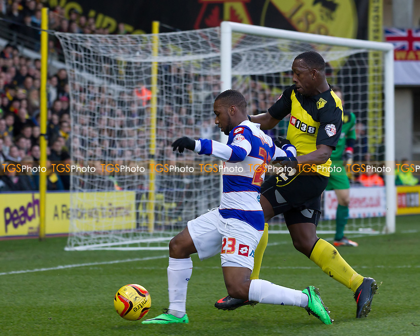 Lloyd Doyley of Watford pushes David Hoilett of Queens Park Rangers wide and away from the hosts danger area - Watford vs Queens Park Rangers - Sky Bet Championship Football at Vicarage Road Stadium, Watford, Hertfordshire - 29/12/13 - MANDATORY CREDIT: Ray Lawrence/TGSPHOTO - Self billing applies where appropriate - 0845 094 6026 - contact@tgsphoto.co.uk - NO UNPAID USE
