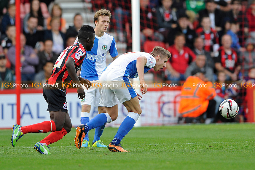 Grant Hanley of Blackburn Rovers keeps his eye on the ball as Tokelo Rantie of AFC Bournemouth challenges - AFC Bournemouth vs Blackburn Rovers - Sky Bet Championship Football at the Goldsands Stadium, Bournemouth, Dorset - 28/09/13 - MANDATORY CREDIT: Denis Murphy/TGSPHOTO - Self billing applies where appropriate - 0845 094 6026 - contact@tgsphoto.co.uk - NO UNPAID USE