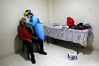 MEDELLIN, COLOMBIA - MAY 22: A health worker samples the COVID-19 test at a patient's home in Medellín, Colombia, on May 22, 2020.The Mayor's Office of Medellín conducts permanent tours in the communes of the city to collect random samples as a preventive measure against the COVID-19 pandemic. (Photo by Fredy Builes/VIEWpress)
