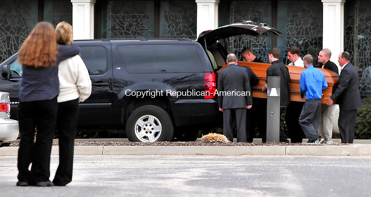 SOUTHBURY, CT-31 MARCH 2010-033110JS01-Friends of Michael Weaving console each other as his casket is loaded into a truck following his funeral Wednesday at Sacred Heart Church in Southbury. Weaving was the victim of a murder last week in Southbury.        <br /> Jim Shannon Republican-American