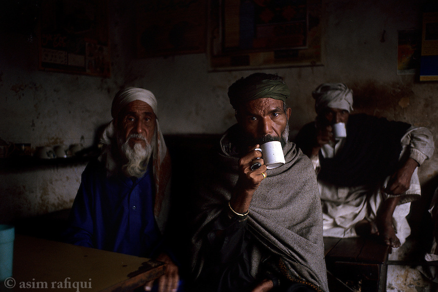 Indigents in a tea stall in the old city of lahore