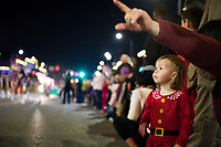 Starkville Christmas parade - child onlooker (parent approved use of photo of child by MSU).<br />  (photo by Megan Bean / &copy; Mississippi State University)