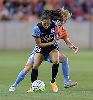Becca Moros (4) of the Houston Dash puts pressure on Christen Press (23) of the Chicago Red Stars in the first half on Saturday, April 16, 2016 at BBVA Compass Stadium in Houston Texas.