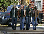 David Bryan, Jon Bon Jovi, Richie Sambora, and Tico Torres walk together while shooting a scene on the set of a Bon Jovi music video being shot at a Habitat for Humanity build site in north Philadelphia, Wednesday, October 26, 2005.(Brian Myrick)