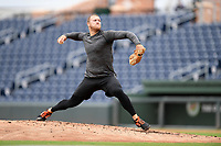 Baltimore Orioles pitcher David Hess delivers a pitch during a live-pitching workout with Major League and Minor League players from around the region on Tuesday, June 16, 2020, at Fluor Field at the West End in Greenville, South Carolina. Team workouts have been shut down during the coronavirus pandemic, so this group began working out in game situation simulations a couple of days a week. (Tom Priddy/Four Seam Images)