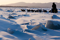 Rick Swenson on the Yukon River two miles after leaving the village checkpoint of Ruby at sunset during the 2010 Iditarod, Interior Alaska