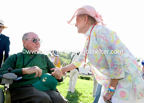 Mary Ann Houghland congratulates Irv Naylor after winning the Grade 1 Iroquois with Tax Ruling.