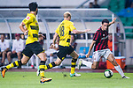 AC Milan Midfielder Giacomo Bonaventura (R) fights for the ball with Borussia Dortmund Midfielder Sebastian Rode (C) during the International Champions Cup 2017 match between AC Milan vs Borussia Dortmund at University Town Sports Centre Stadium on July 18, 2017 in Guangzhou, China. Photo by Marcio Rodrigo Machado / Power Sport Images