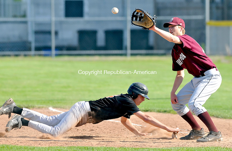 TORRINGTON, CT-13 MAY 2009-051309JS07-Watertown's Chris Mondak (14) dives safely back to first as Torrington's Austin Poucher (13) covers the bag on a pick-off attempt during their game Wednesday at Fuessenich Park in Torrington. <br /> Jim Shannon Republican-American