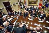 United States President Donald Trump makes remarks as he hosts a breakfast and listening session with key business leaders in the Roosevelt Room of the White House in Washington, DC on Monday, January 23, 2017.<br /> Credit: Ron Sachs / Pool via CNP