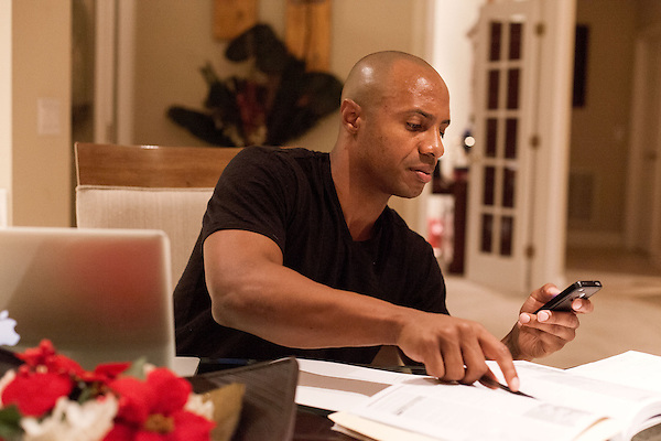 December 14, 2012. Durham, North Carolina.. Jay Williams does research to get ready for a UNC vs. ECU basketball game the following day. Prepping for each game he covers as an ESPN analyst can take hours.. Jay Williams, a former point guard for the Chicago Bulls, is now a college basketball analyst for ESPN. Williams was a freshman all american at Duke University and helped lead the Blue Devils to a NCAA National Championship in 2001. . After being drafted in 2002 to the Chicago Bulls, he played one season in the NBA before his basketball career was ended by a serious motorcycle accident which nearly took his life.