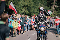 pre-race police pilot warming up the crowd for an upcoming rider<br /> <br /> MEN ELITE ROAD RACE<br /> Kufstein to Innsbruck: 258.5 km<br /> <br /> UCI 2018 Road World Championships<br /> Innsbruck - Tirol / Austria