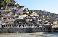 Houses in the Mangalem Quarter or Old Town and the Osum river, with the Bachelors' Mosque or Xhami e Beqareve, built in 1827, on the far right, in Berat, South-Central Albania, capital of the District of Berat and the County of Berat. In July 2008, the old town (Mangalem district) was listed as a UNESCO World Heritage Site. Picture by Manuel Cohen