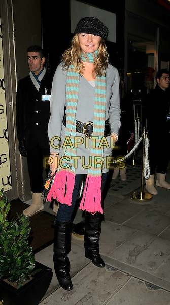 JODIE KIDD.The UGG Australia: London Store Launch in Covent Garden, London, England. .November 26th, 2008 .full length jeans denim tucked into boots grey gray top belt hat blue brown pink striped stripes scarf hand in pocket .CAP/CAN.©Can Nguyen/Capital Pictures.