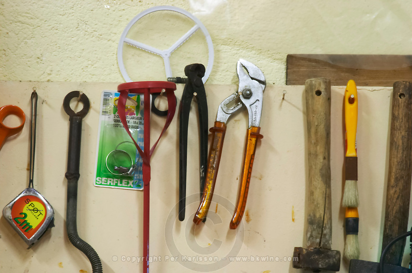 Domaine Mas Cal Demoura, in Jonquieres village. Terrasses de Larzac. Languedoc. Tools hanging on a wall. France. Europe.