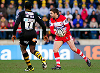 Nicky Robinson prepares to pass the ball along his backline. Guinness Premiership match between London Wasps and Gloucester on March 7, 2010 at Adams Park in High Wycombe, England. [Mandatory Credit: Patrick Khachfe/Onside Images]