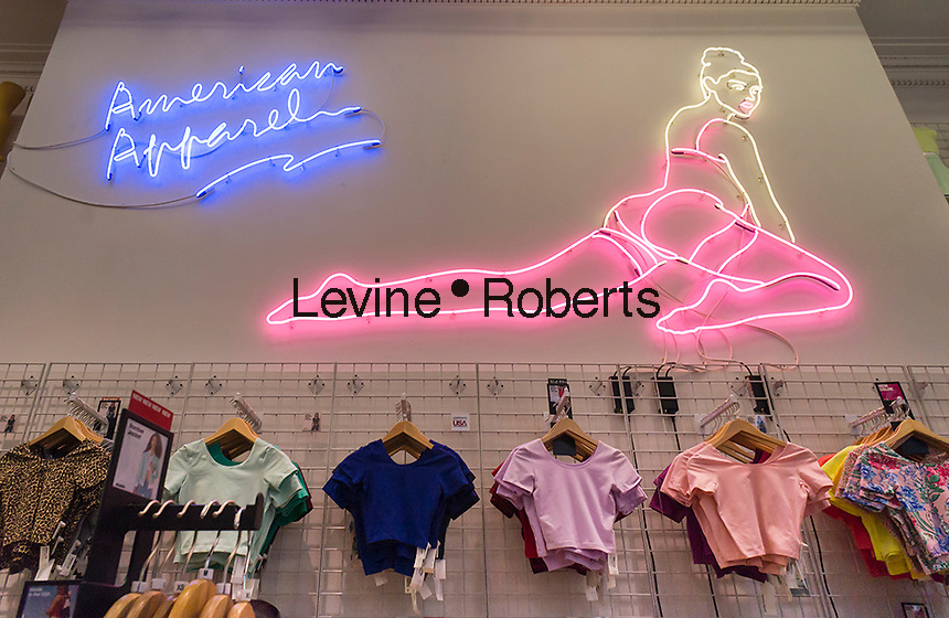 An American Apparel store in the Flatiron neighborhood of New York promotes their lingerie with a risqué neon sign, seen on Friday, July 4, 2014. The ousted CEO Dov Charney has increased his holdings in the company to 43 percent in an effort to regain control of the company.   (© Richard B. Levine)