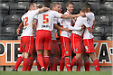 James Dunne of Stevenage celebrates with team-mates<br />  - Notts County v Stevenage - Sky Bet League One - Meadow Lane, Nottingham - 24th August 2013<br /> © Kevin Coleman 2013