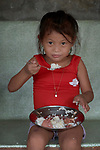A girl eats a meal in a preschool sponsored by the Kapatiran-Kaunlaran Foundation (KKFI) in Pulilan, a village in Bulacan, Philippines.<br /> <br /> KKFI is supported by United Methodist Women.