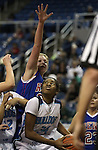 Reno's Morgan McGwire defends Centennial shooter Breanna Workman during a semi-finals game in the NIAA 4A State Basketball Championships between Centennial and Reno high schools at Lawlor Events Center in Reno, Nev, on Thursday, Feb. 23, 2012. Reno won 60-41. .Photo by Cathleen Allison