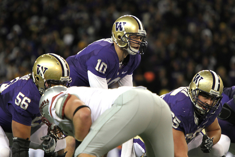 Jake Locker (#10), University of Washington quarterback, prepares to take the snap from center, Ryan Tolar, during the Huskies Pac-10 conference football game against arch-rival Washington State at Husky Stadium in Seattle, Washington, on November 28, 2009.  Washington shut out the Cougars in their annual Apple Cup battle, 30-0.