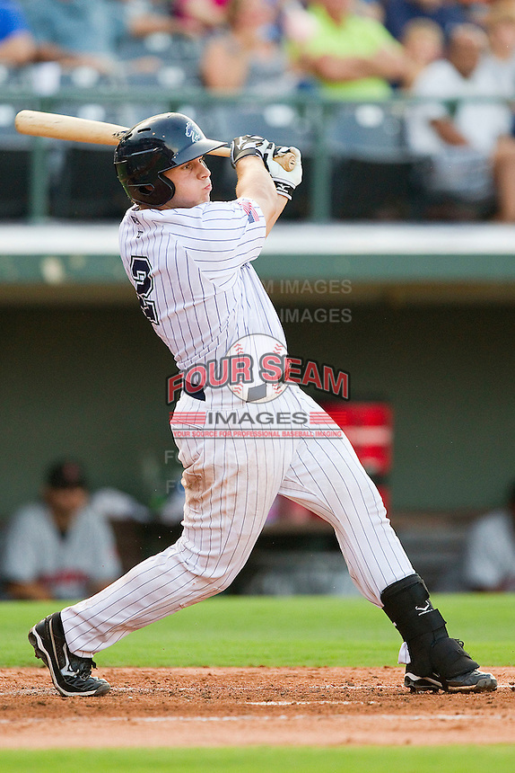 Josh Phegley #2 of the Charlotte Knights follows through on his swing against the Indianapolis Indians at Knights Stadium on July 26, 2011 in Fort Mill, South Carolina.  The Knights defeated the Indians 5-4.   (Brian Westerholt / Four Seam Images)