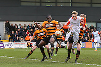 Joe Pigott of Luton Town (right) and John Akinde of Barnet (2nd right) battle for the ball in the Barnet penalty box during the Sky Bet League 2 match between Barnet and Luton Town at The Hive, London, England on 28 March 2016. Photo by David Horn.