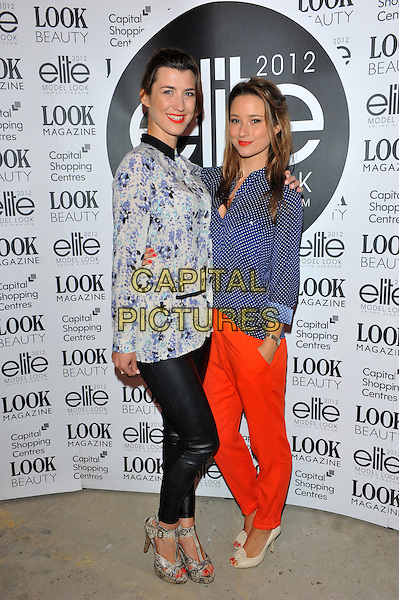 Izzy Lawrence & Kelly Eastwood.The final of the Elite Model Look 2012 competition, a nationwide search to find the supermodels of the future, P3, 35 Marylebone Road, London, England..August 30th, 2012.full length hand on hip pink blue purple green print top black leather trousers snakeskin shoes sandals dress blue white polka dot shirt red trousers beige peep toe shoes .CAP/CJ.©Chris Joseph/Capital Pictures.