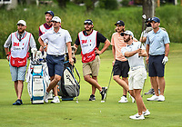 22nd July 2020; Blaine, Minnesota, USA;  Matthew Wolff hits his approach shot as Will Gordon, Tommy Fleetwood, Paul Casey, and their caddies look on during the 3M Open Compass Challenge at TPC Twin Cities in Blaine, Minnesota