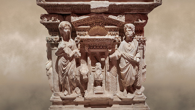 "Roman relief sculpted sarcophagus of Domitias Julianus and Domita Philiska, 2nd century AD, Perge. Antalya Archaeology Museum, Turkey.<br /> <br /> <br /> it is from the group of tombs classified as. ""Columned Sarcophagi of Asia Minor"". <br /> The lid of the sarcophagus is sculpted into the form of a ""Kline"" style Roman couch on which lie Julianus &  Philiska. This type of Sarcophagus is also known as a Sydemara Type of Tomb.. Against a warm art background."