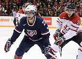 Kyle Palmieri (USA - 23), Jared Cowen (Canada - 22) - Team Canada defeated Team USA 5-4 (SO) on Thursday, December 31, 2009, at the Credit Union Centre in Saskatoon, Saskatchewan, during the 2010 World Juniors tournament.