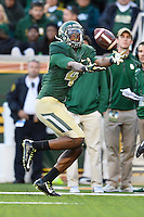 Baylor wide receiver Jay Lee (4) reaches for the ball during NCAA football game, Saturday, November 01, 2014 in Waco, Tex. Baylor defeated Kansas 60-14. (Mo Khursheed/TFV Media via AP Images)