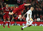 James Milner of Liverpool flies in to tackle Radja Nainggolan of AS Roma during the Champions League Semi Final 1st Leg match at Anfield Stadium, Liverpool. Picture date: 24th April 2018. Picture credit should read: Simon Bellis/Sportimage