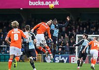 Aaron Pierre of Wycombe Wanderers & Joe Pigott of Luton Town go up for the ball during the Sky Bet League 2 match between Wycombe Wanderers and Luton Town at Adams Park, High Wycombe, England on 6 February 2016. Photo by Andy Rowland.