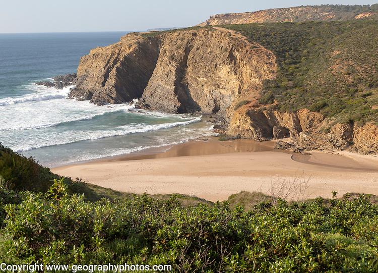 Sandy Carvalhal beach in bay between rocky headlands at Parque Natural do Sudoeste Alentejano e Costa Vicentina, Costa Vicentina natural park, near Brejão, south west Alentejo, Alentejo Littoral, Portugal, Southern Europe