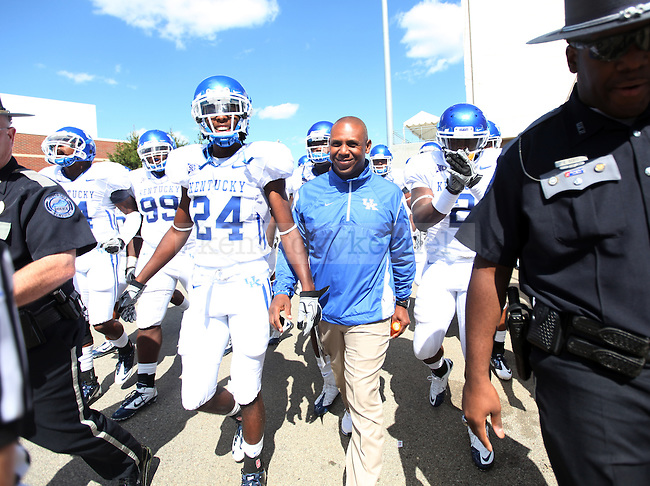 UK head coach Joker Phillips walks out of the locker room and onto the field before the first half of the UK vs Uof L football game, kicking off Joker Phillip's reign as head coach on Saturday, September 5, 2010. Photo by Britney McIntosh | Staff