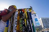 Rio de Janeiro, Brazil. Beach vendor with sarongs and credit card sign.